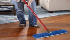 Cleaning Floors And Furniture With A Dry Cleaning Mop